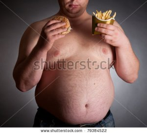 fat-man-with-hamburger-and-chips-on-dark-background-79384522