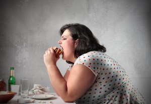 bigstock-Fat-woman-eating-a-hamburger-12163661