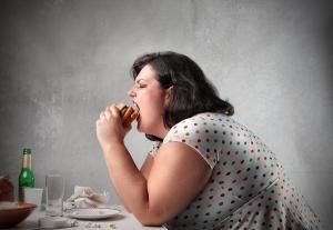 bigstock-Fat-woman-eating-a-hamburger-12163661