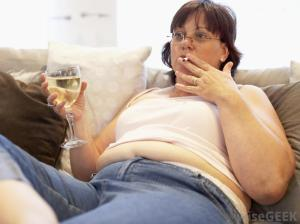 woman-smoking-and-drinking-on-couch